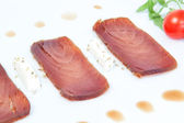 Closeup of the three slices of smoked tuna. — Stock Photo