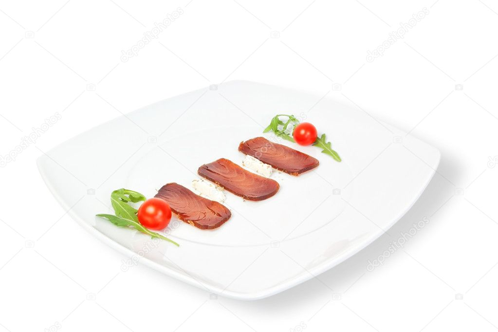 The composition of smoked tuna on a plate. On a white background.  Stock Photo #9814315