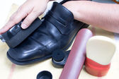 Cleaning shoes — Stock Photo