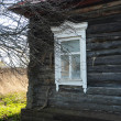 Wall of the old wooden country house with a window. - Stock Photo