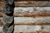 Wall of the old wooden houses, logs. — Stock Photo