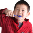 Royalty-Free Stock Photo: A happy child brushing teeth,