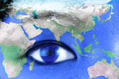 Woman's eye with world — Stock Photo