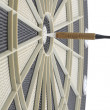 Many darts in bulls eye of dartboard — Stock Photo
