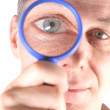 Royalty-Free Stock Photo: Man looking with magnifying glass