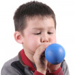 Child is blowing balloon — Stock Photo