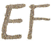 Letter E F compose by tea leaves — Stock Photo