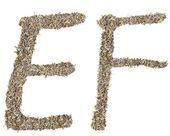 E f письмо сочинять, листья чая — Стоковое фото
