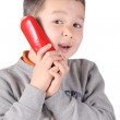 Foto Stock: Child is talking with telephone