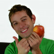 Good looking guy with apple, OK sign — Stock Photo #8005258