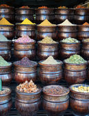 Traditional baskets of colorful spices in shop — Stock Photo