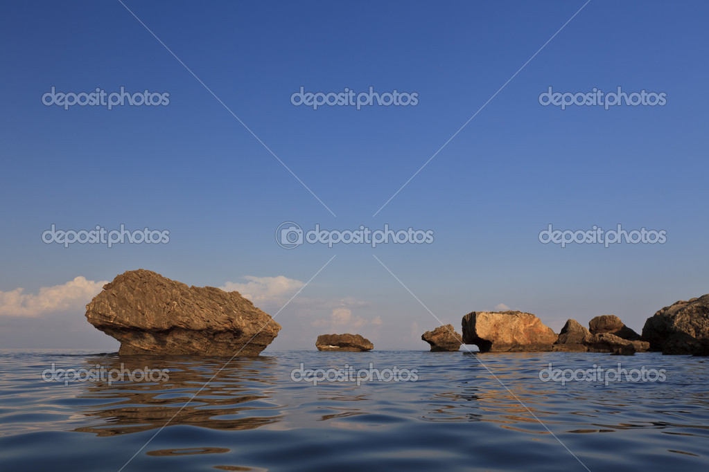 Stones in water on the beach Porto Zoro, Zakynthos, Greece — Stock Photo #9978288