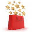 Red Shopping bag and gold stars. Isolated on white — Stockfoto