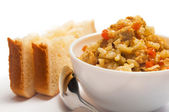 Pilaf with meat, carrots and two slices of bread — Stock Photo