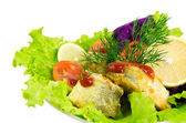 Green salad and fried fish — Stock Photo