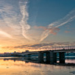 Beautiful sunrise in city over bridge — Stock Photo