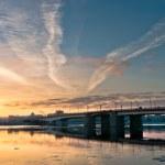 Beautiful sunrise in city over bridge — Stock Photo