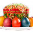 Easter eggs and cake on big plate — Stock Photo