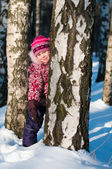 Baby stands in wood — Stock Photo