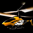 Stock Photo: Radio helicopter isolated on black