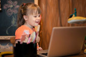 Young girl laughing with laptop — Foto de Stock