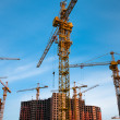 Crane in front of the building — Stock Photo