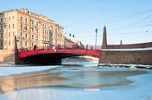 Small red bridge and channel — Stock Photo