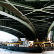 Tugs under the green bridge — Stock Photo