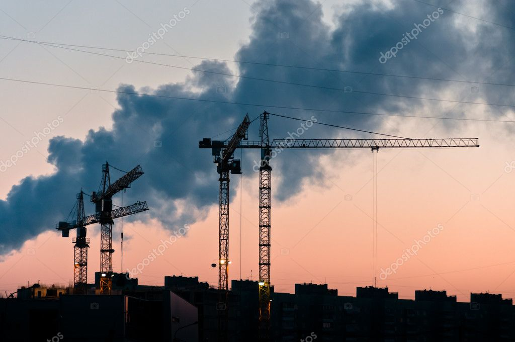 Cranes silhouettes with smoke on background at the morning with clear sky — Stock Photo #9378785