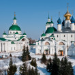 Men monastery in snow — Stock Photo