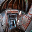 Stairs tunnel in abandoned church — Stock Photo