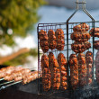 Cooking sausages on grill - Stock Photo
