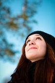 Beautiful girl looking up — Stock Photo