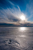 Beautiful cloudy sky over ice — Stock Photo