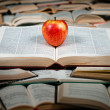 Red apple on big book — Stock Photo