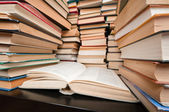 Stacks of books on black table — Stock Photo