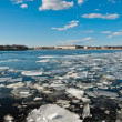 Broken ice pieces floating on river — Foto Stock