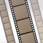 Постер, плакат: 35mm movie film reel filmstrip photo roll negative reel movie camera cinematic hollywood