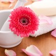 Soap with rose leafs on towel and mortar — Stock Photo