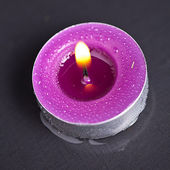 Candel with flamme on water — Stock Photo
