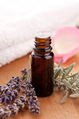 Lavendel and parfum bottle with towel — Stock Photo
