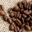 Brown Coffee Beans on a jute bag — Stock Photo #9104262