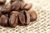 Brown Coffee Beans on a jute bag — Stock Photo