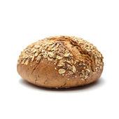 Beyaz zemin üzerine kepekli ekmek — Stok fotoğraf