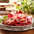 Salami and ham — Stock Photo