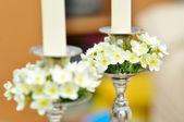 White flowers on candle holder — Stok fotoğraf