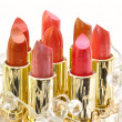 Set of lipsticks decorated with beads — Stock Photo