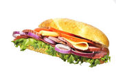 Sandwich with lettuce hum tomato cheese and red onion — Stock Photo