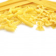 Closeup of italian pasta farfalle spaghetti with text area — Stock Photo #9657274