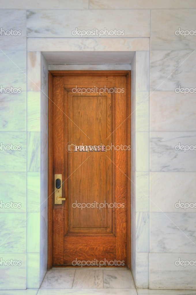 Closed Oak Door Surrounded by marble. Keep out, Privacy. — Stock Photo #10430503